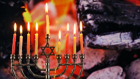 Jewish holiday Hanukkah with menorah traditional burning candles, fire burns in Footage