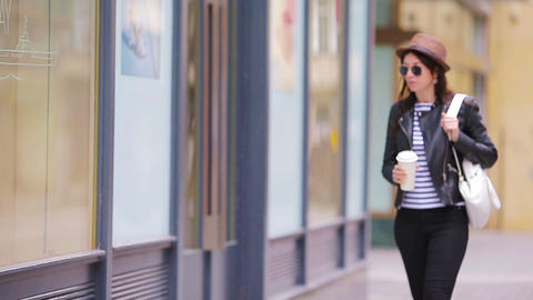 Happy young urban woman drinking coffee in european city. Travel tourist woman Footage
