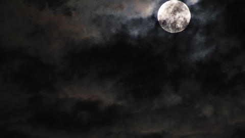 Mysterious night sky with full moon dramatic clouds in the moonlight from full Live Action