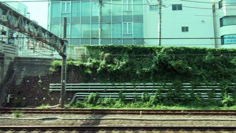 Japan Railway train window. Tokyo, parallel with commuter train Live Action