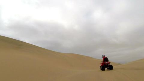 Quad biking through the sand dunes of Namib Desert, Namibia Footage