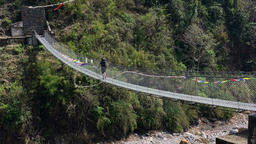 Hiker walking mountain suspension bridge. Himalayas Nepa HD video Footage