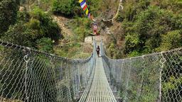 Himalayas Nepal travel HD video. Hiker walking mountain suspension bridge Footage