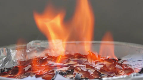 Burning pieces of paper in a plate Footage