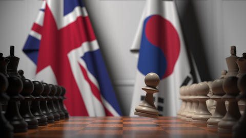 Chess game against flags of Great Britain and Korea. Political competition Live Action