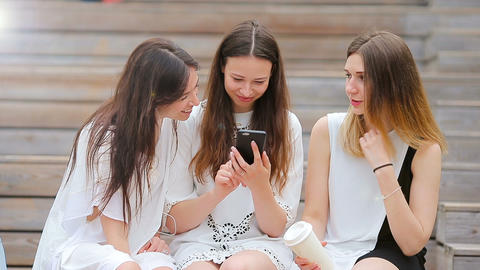 Lifestyle selfie portrait of young positive girls having fun and making selfie Footage