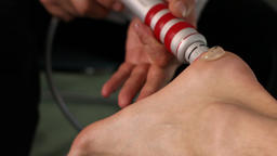 Shock wave therapy, heel treatment procedure.Close up Live Action
