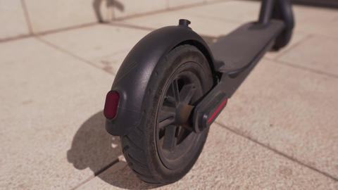 Close-up of the rear black wheel of an electric bike. Alternative transport, eco Live Action