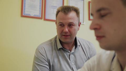 Male patient tells doctor his health complaints Live Action