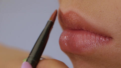 Makeup artist applying lipstick Live Action