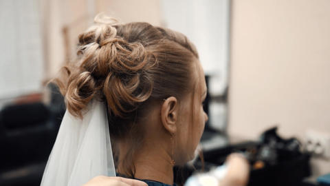 hairdresser doing hairstyle in a beauty salon Live Action