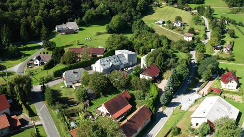 Alpine village Kopivnik in Slovenia, aerial view, Pohorje landscape Live Action