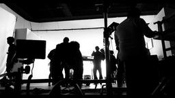Behind the shooting video production and lighting set for filming which movie crew team working and Photo