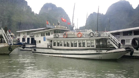 Wooden sail boats at Halong bay with the Limestone Mountains at the background Footage