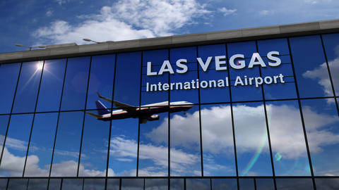 Airplane landing at Las Vegas Nevada mirrored in terminal Live Action