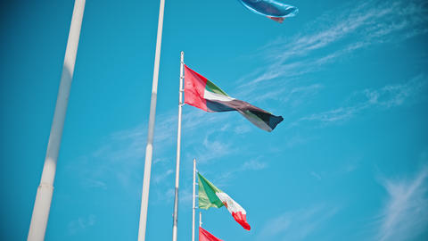 Flags of the world countries blowing in the wind on a background of the bright Footage