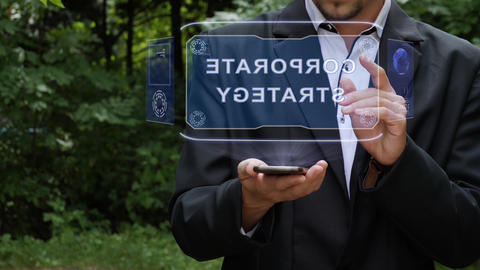 Businessman uses hologram with text Corporate strategy Footage