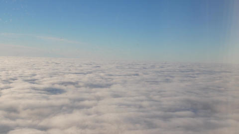 Fly Above the Clouds at Blue Sky Background Footage
