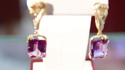 Jewellery.Close-up of the magenta diamond earrings in the jewelry store.Shallow Live Action