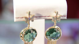 Close-up of the green diamond earrings in the jewelry store.Jewellery.Shallow Live Action