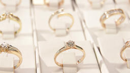 Jewellery.A lot of gold rings set with diamonds in the window of a jewelry store Live Action
