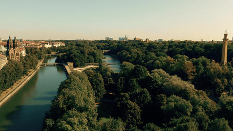 Aerial view of the River Isar and the dam within city limits of Munich, Germany Live Action