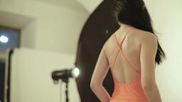 Backstage photography. Photoshoot. Model posing to the photographer Archivo