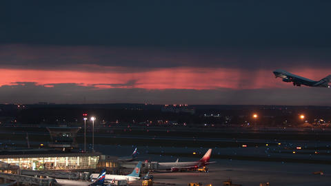 Evening view of Sheremetyevo Airport and AirBridgeCargo plane departing, Moscow Live Action