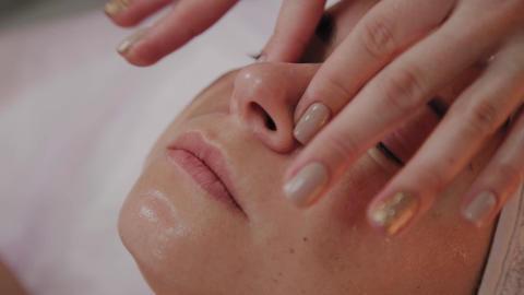 Spa woman facial Massage. Face Massage in beauty spa salon. Female enjoying Live Action