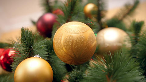 Closeup 4k footage of beautiful golden bubable hanging and rotating on Christmas Footage