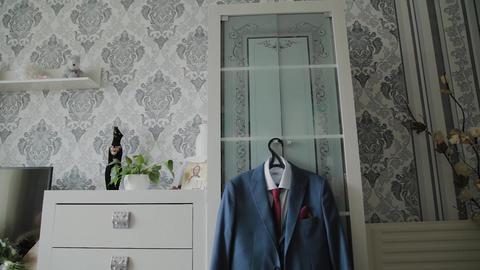 Men's jacket hanging on a closet Footage