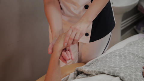 Very beautiful girl gets a massage on her hands in the spa salon Live Action
