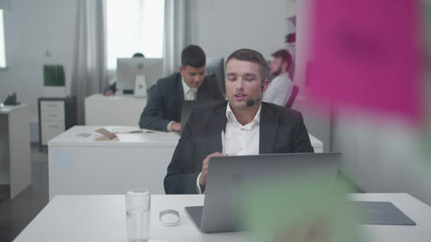 Young man have a bussiness conversation Footage