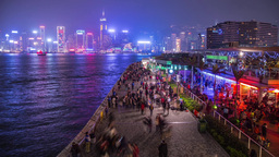 People walking by victoria harbour in Hong Kong Stock Video Footage