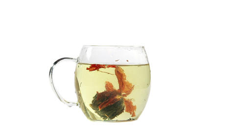 Cup with tea bud and boiling water Stock Video Footage