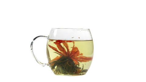 Cup With Tea Bud And Boiling Water stock footage