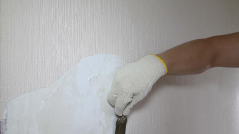 Man removing old wallpaper with the tool, timelapse Stock Video Footage