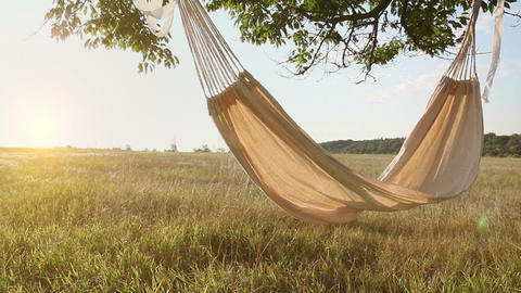 Hammock swinging on the wind at sunset Stock Video Footage