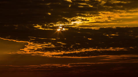 Sunrise behind clouds with light rays Stock Video Footage