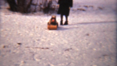 Girl Sledding With Her Family 1942 Vintage 8mm Film stock footage