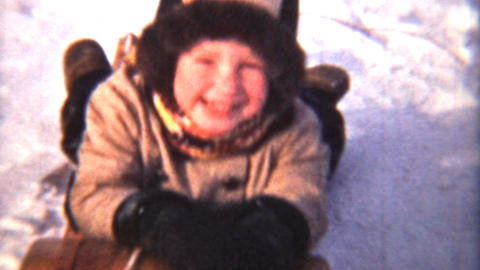 Girl Sledding With Her Family 1942 Vintage 8mm film Stock Video Footage