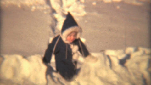 Little Girl Plays In The Snow 1940 HD Vintage 8mm Film stock footage