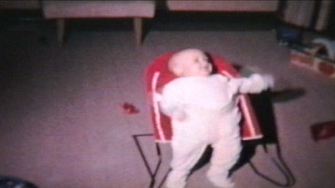 Boy In Baby Bouncer 1964 Vintage 8mm film Stock Video Footage