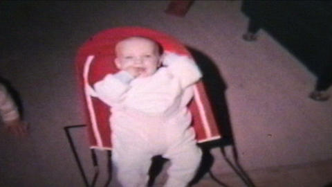 Boy In Baby Bouncer 1964 Vintage 8mm Film stock footage