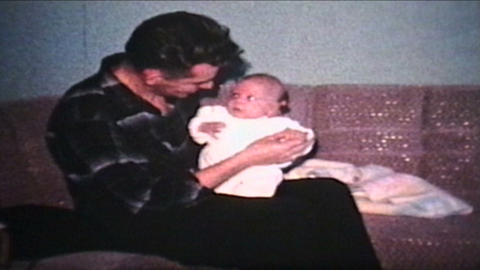 Dad Picking Up His Baby Boy 1962 Vintage 8mm film Stock Video Footage