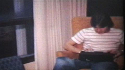 Teenager Gets Clock Radio For Birthday 1978 Vintage 8mm film Stock Video Footage