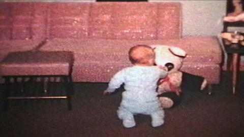 Baby Crawling And Playing With Bear 1963 Vintage 8mm film Stock Video Footage