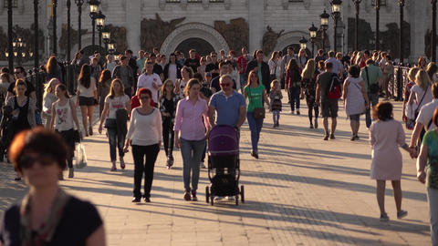 Families with baby strollers, kick scooter, bicycle, citizens walk around bridge Footage
