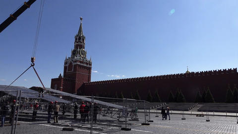 Construction dismantling works at Red Square, personnel remove temporary scene Live Action