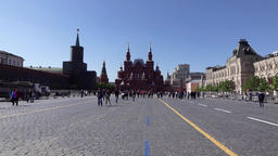 Tourist gaze around Red Square near State Department Store and Historical Museum Footage